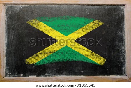 Chalky jamaican flag painted with color chalk on old blackboard - stock photo