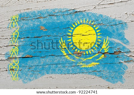 Chalky kazakstan flag painted with color chalk on grunge wooden texture - stock photo