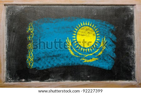 Chalky kazakstan flag painted with color chalk on old blackboard - stock photo