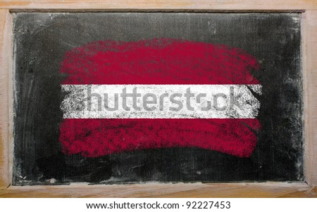Chalky latvian flag painted with color chalk on old blackboard - stock photo