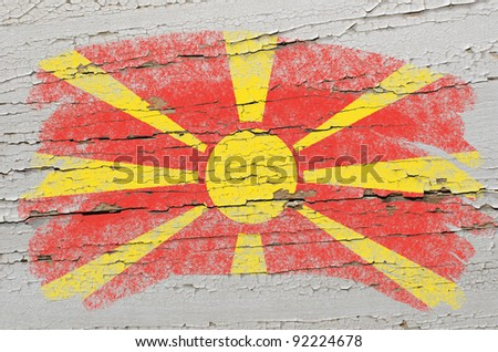 Chalky macedonian flag painted with color chalk on grunge wooden texture - stock photo