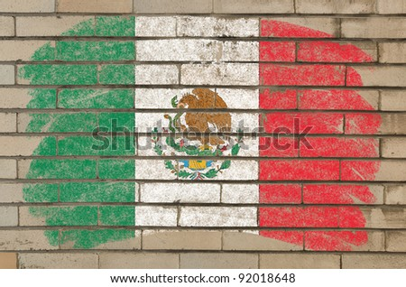 Chalky mexican flag painted with color chalk on grunge old brick wall - stock photo