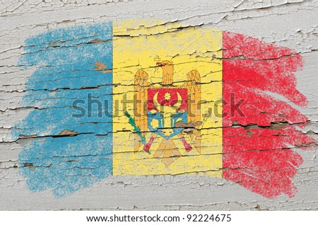 Chalky moldova flag painted with color chalk on grunge wooden texture - stock photo