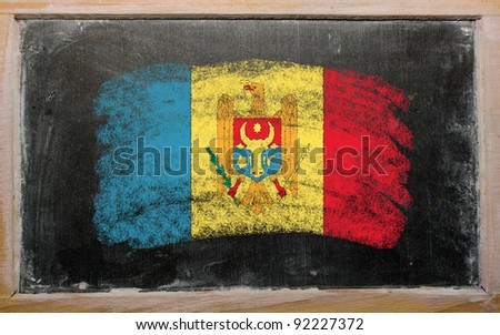 Chalky moldova flag painted with color chalk on old blackboard - stock photo