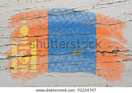 Chalky mongolia flag painted with color chalk on grunge wooden texture - stock photo