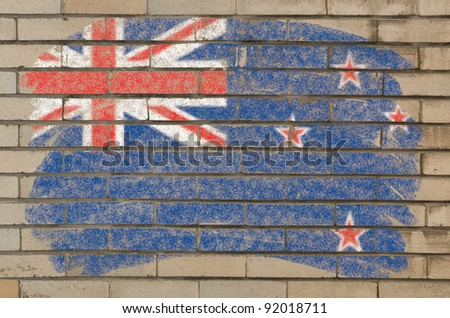 Chalky new zealand flag painted with color chalk on grunge old brick wall - stock photo