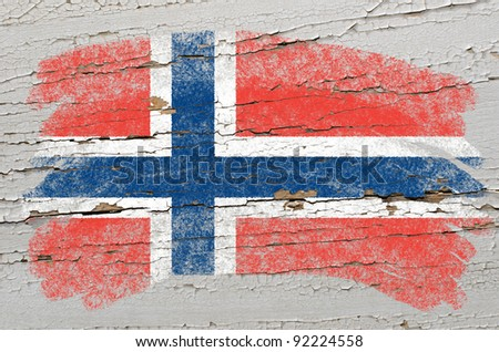 Chalky norwegian flag painted with color chalk on grunge wooden texture - stock photo