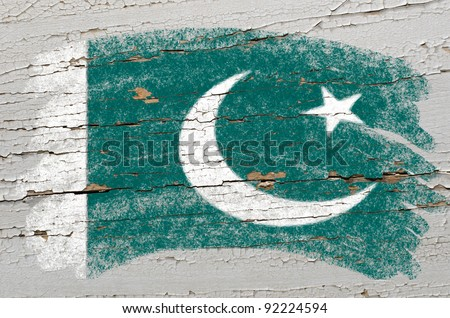 Chalky pakistan flag painted with color chalk on grunge wooden texture - stock photo