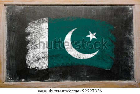 Chalky Pakistan flag painted with color chalk on old blackboard - stock photo