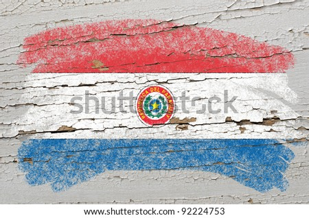 Chalky paraguay flag painted with color chalk on grunge wooden texture - stock photo