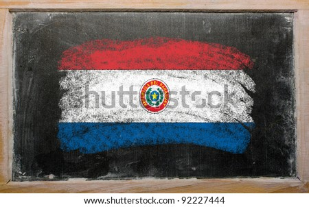 Chalky paraguay flag painted with color chalk on old blackboard - stock photo