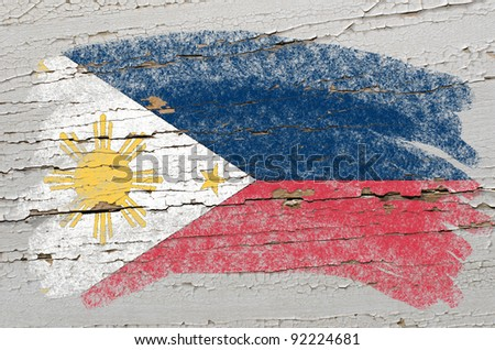 Chalky phillip flag painted with color chalk on grunge wooden texture - stock photo