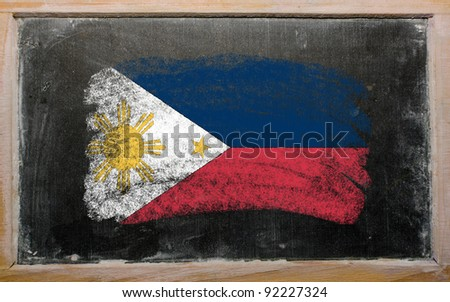 Chalky phillip flag painted with color chalk on old blackboard - stock photo