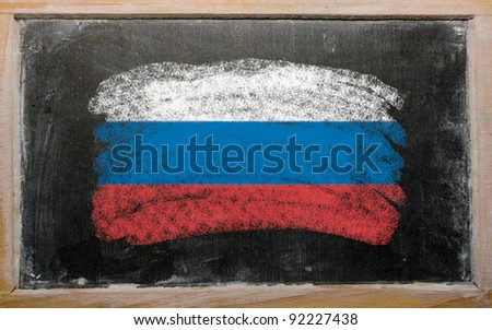 Chalky russian flag painted with color chalk on old blackboard - stock photo