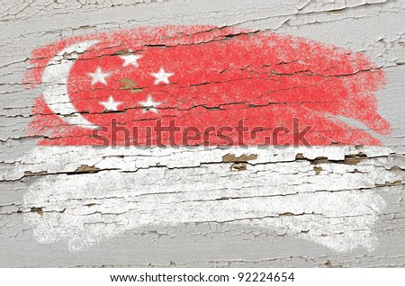 Chalky singapore flag painted with color chalk on grunge wooden texture - stock photo