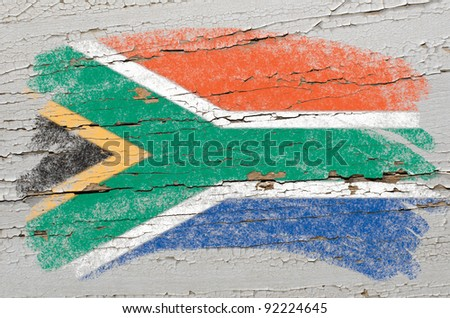 Chalky south, african republic flag painted with color chalk on grunge wooden texture - stock photo
