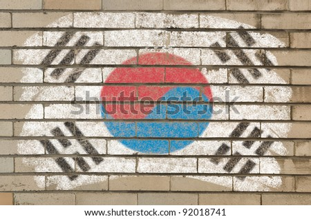 Chalky south korean flag painted with color chalk on grunge old brick wall - stock photo