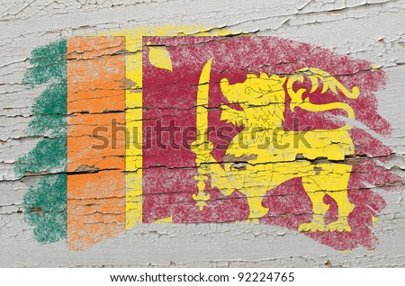 Chalky srilankan flag painted with color chalk on grunge wooden texture - stock photo