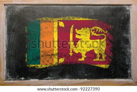 Chalky srilankan flag painted with color chalk on old blackboard - stock photo