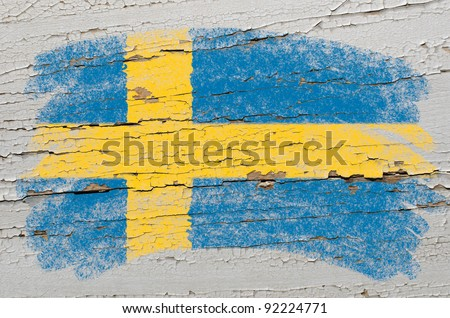 Chalky swedish flag painted with color chalk on grunge wooden texture - stock photo