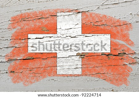 Chalky swiss flag painted with color chalk on grunge wooden texture - stock photo