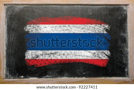 Chalky thailand flag painted with color chalk on old blackboard - stock photo