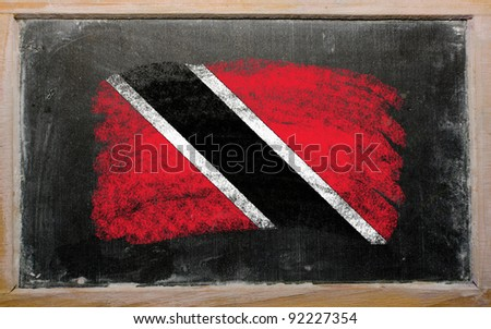 Chalky trinidad and tobago flag painted with color chalk on old blackboard - stock photo
