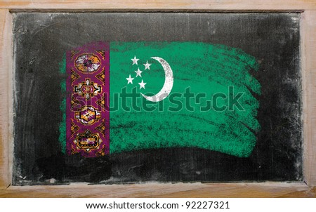 Chalky turkmenistan flag painted with color chalk on old blackboard - stock photo