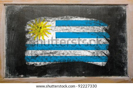 Chalky uruguay flag painted with color chalk on old blackboard - stock photo