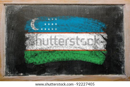 Chalky uzbekistan flag painted with color chalk on old blackboard - stock photo