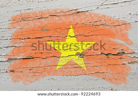 Chalky vietnamese flag painted with color chalk on grunge wooden texture - stock photo