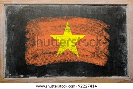 Chalky vietnamese flag painted with color chalk on old blackboard - stock photo