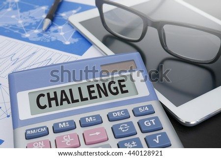 CHALLENGE Calculator  on table with Office Supplies. ipad - stock photo