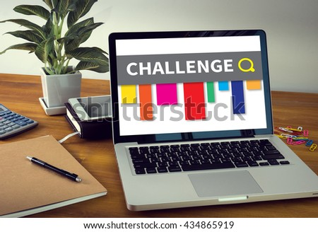CHALLENGE Laptop on table. Warm tone - stock photo
