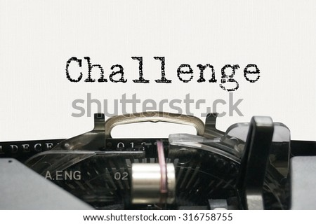 Challenge on typewriter - stock photo