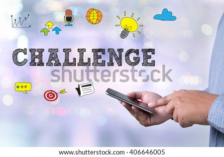 CHALLENGE person holding a smartphone on blurred cityscape background - stock photo