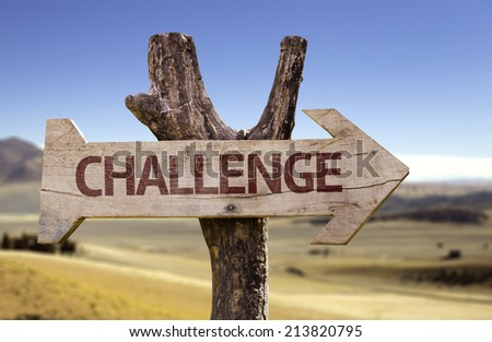 Challenge wooden sign with a desert background  - stock photo