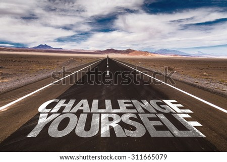 Challenge Yourself written on desert road - stock photo