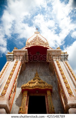 Chalong pagoda with blue clear sky at Chalong Temple, Phuket southern of Thailand. - stock photo