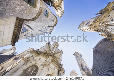 CHAMBORD, FRANCE - SEPTEMBER 25, 2011: wide view of the royal castle of Chambord, France. This castle is located in the Loire Valley is one of the most recognizable castles in the world. - stock photo