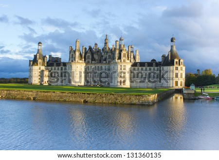 Chambord palace after rain at sunset, Loire Valley, France - stock photo