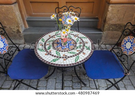 chamomile on a round table with mosaic