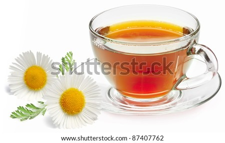 Chamomile tea on a white background. - stock photo