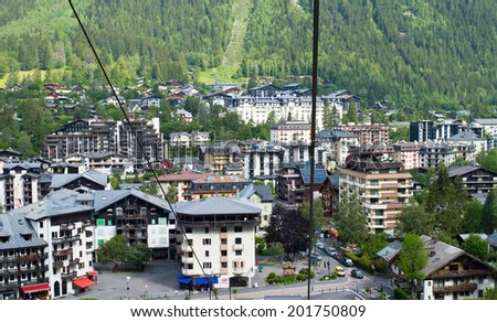 CHAMONIX, FRANCE - JUNE 02, 2014 : Panorama of ski and summer resort Chamonix, France from the lift to Aiguille du Midi on June 02, 2014. - stock photo