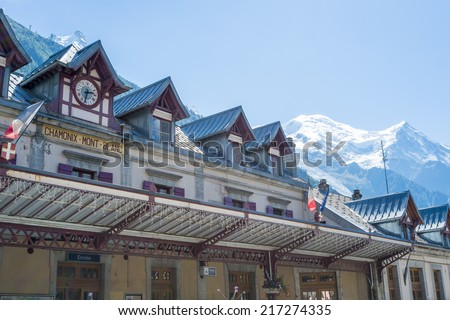 CHAMONIX, FRANCE - SEPTEMBER 02: Facade of Chamonix train station, with Mont Blanc in the background. The city is one of the stages in the popular Mont Blanc tour. September 02, 2014 in Chamonix. - stock photo