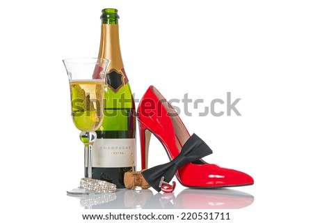 Champagne and black tie with red shoes and accessories isolated on a white background. - stock photo