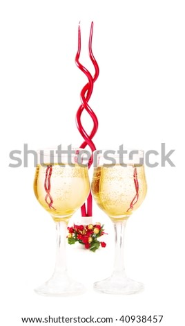 champagne and candle isolated on white