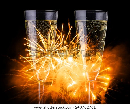 Champagne and fireworks - happy new year - stock photo
