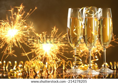 Champagne and fireworks,new year celebration. - stock photo