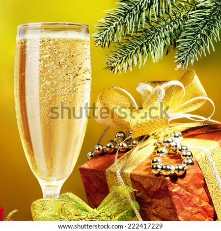 Champagne and gift. Christmas background